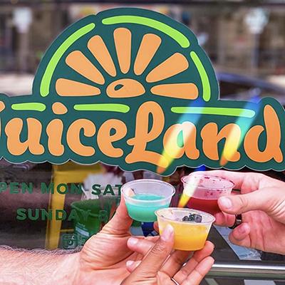three people holding juiceland cold pressed juice